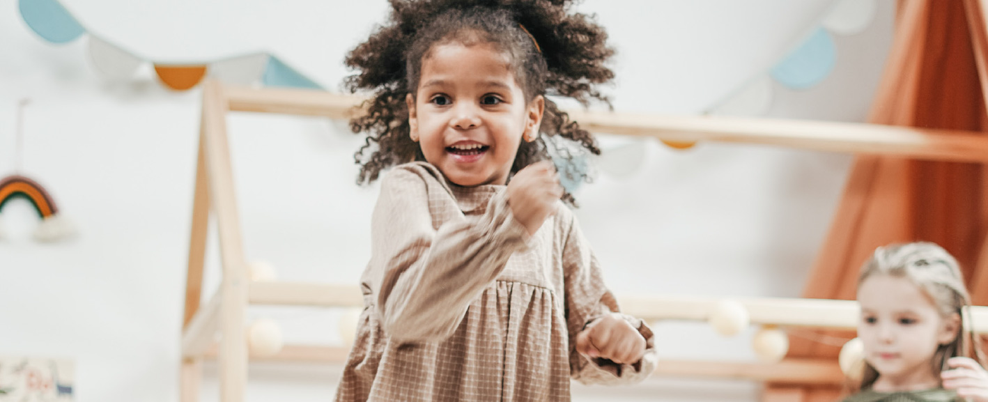 smiling child dancing at nursery