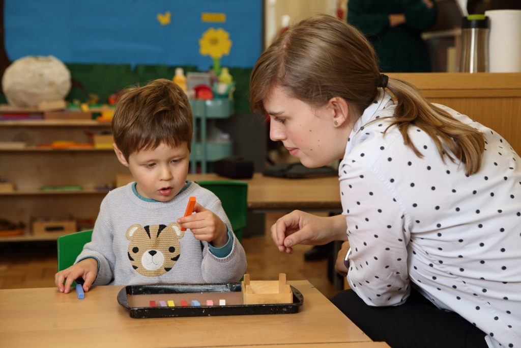 nursery child and teacher learning together