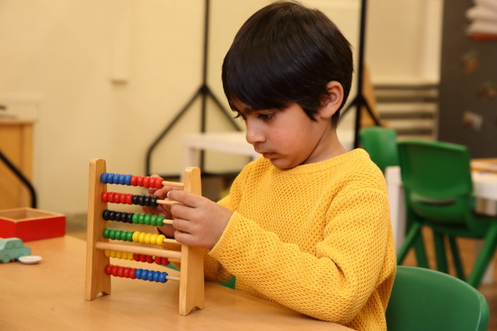 young boy using an abacus