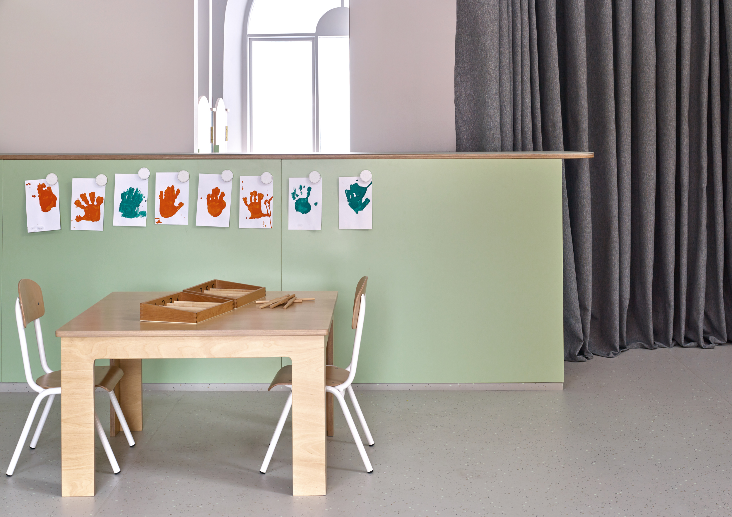 A new area of study for children, with handprints from students stuck up on the nearby wall